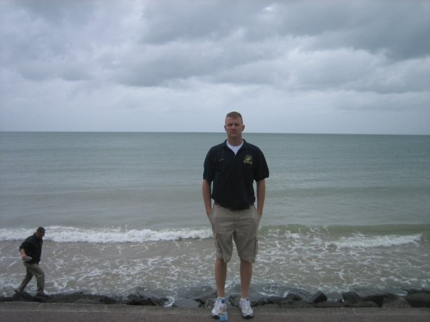 Standing at the waters edge that were turned red on D-Day.